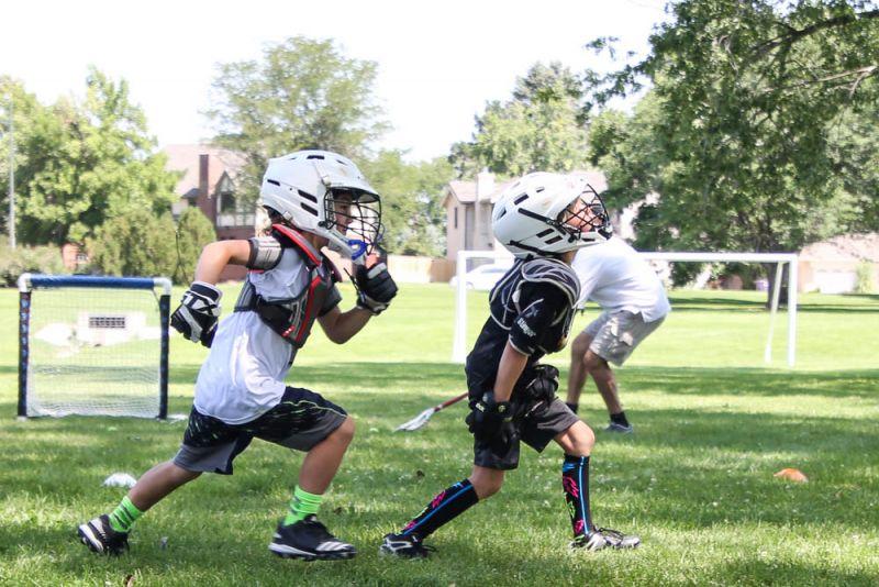 Boys Playing Lacrosse at Dream Big Summer Day Camp | Hilltop Denver and Greenwood Village