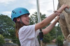 Girl Rock Climbing at Dream Big Summer Day Camp | Hilltop Denver and Greenwood Village