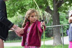 Girl Learning Archery at Dream Big Summer Day Camp | Hilltop Denver and Greenwood Village