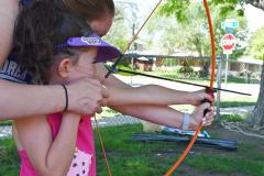Kindergartner Learning Archery at Dream Big Summer Day Camp | Hilltop Denver and Greenwood Village
