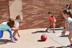 Kindergartner Kids Playing with Ball Outside at Dream Big Summer Day Camp | Hilltop Denver and Greenwood Village